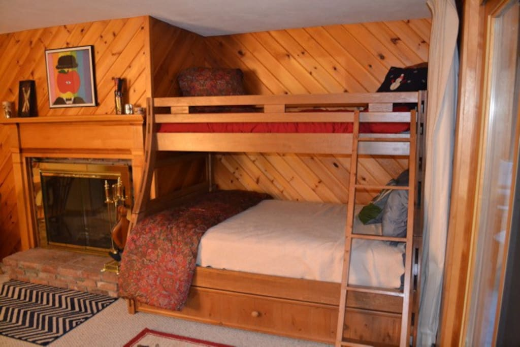 Bunk sleeps 4- twin on top, Full main bed, and twin trundle below.