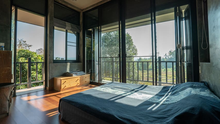 Bedroom 1: Step onto your balcony, absorb the view, overlooking Kamin's organic rice and rose fields.