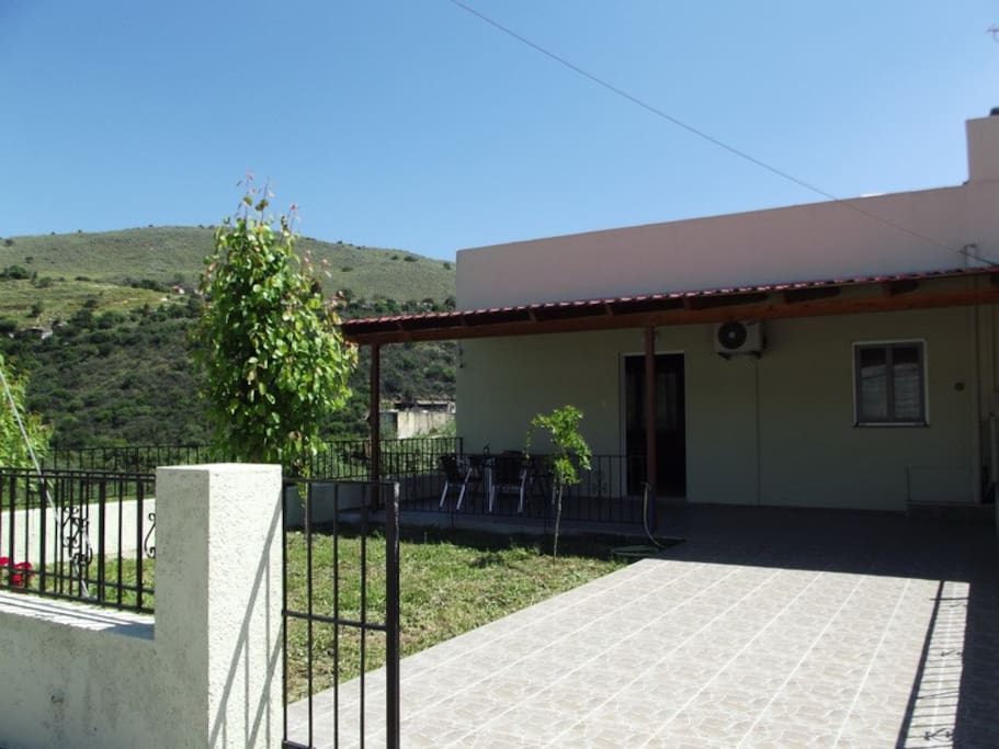 private entrance, yard and parking space