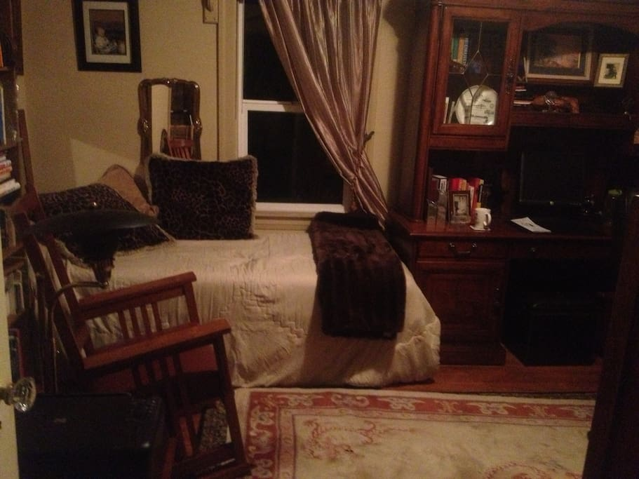 Upstairs bedroom with full bed, comfortable chairs, two executive desks. Window by bed and large window over desk look onto the gardens and provide great light.