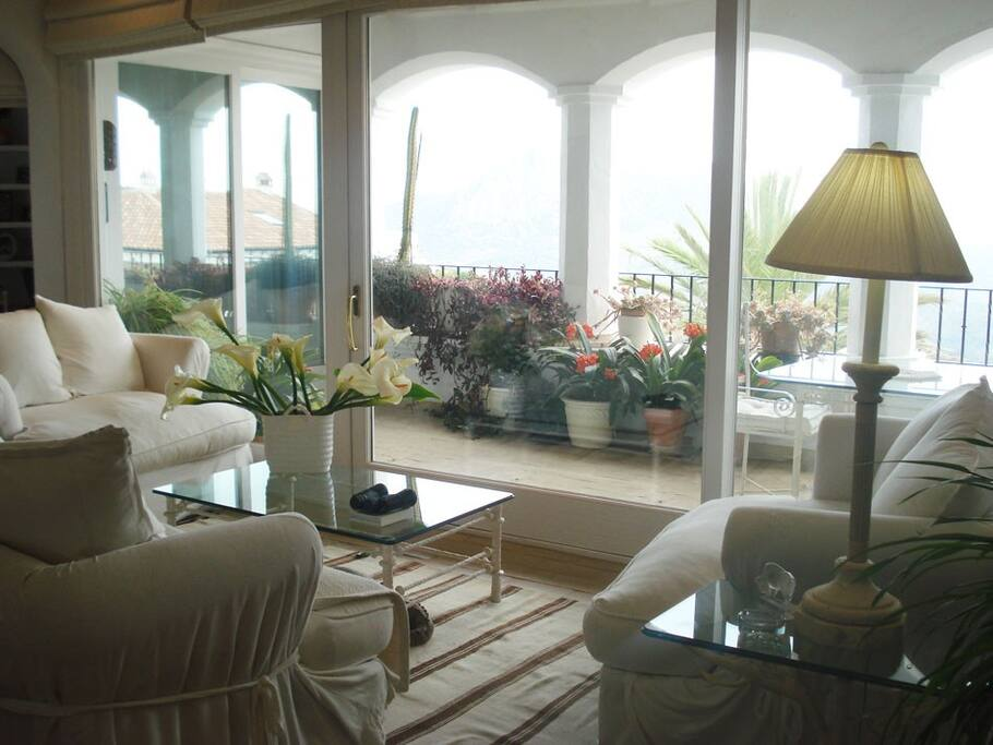 Living room w/sliding glass doors opens onto covered terrace