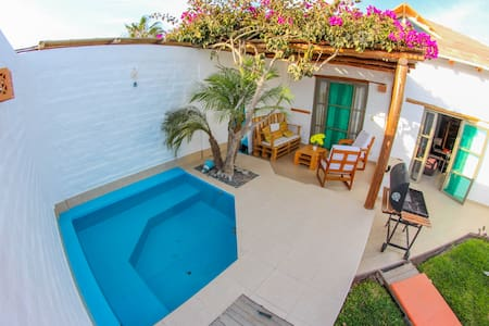 Hermosa casa de playa privada frente a la bahía