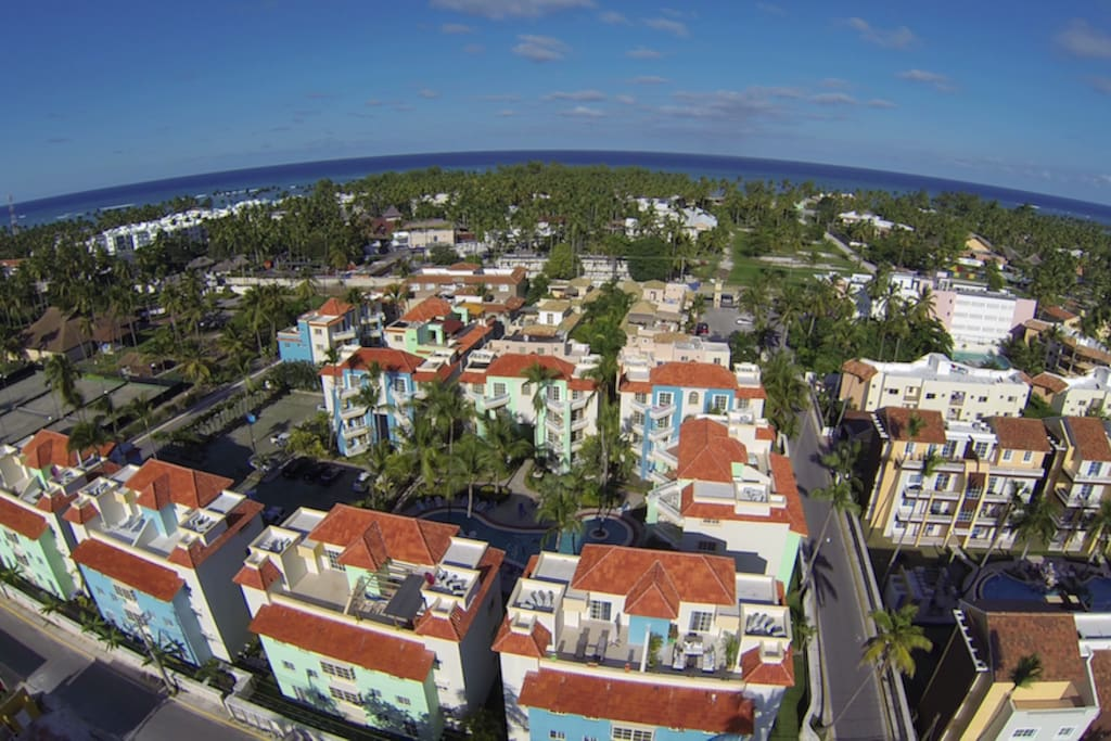 Drone view of Palm Suites, Cortecito and the ocean. The F Building is in the bottom right of the photo. We own the entire 3rd and 4th floors of the building.
