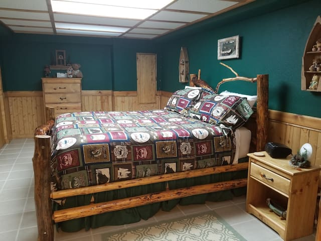 Both bedrooms have a queen log bed.  This bedroom is large enough to put toddler beds or a pack and play for the little ones to be in the same room as you. We have 2 toddler beds and a pack and play, available upon request. Dresser and full closet.