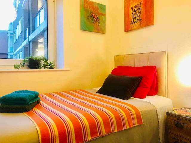 Bright and Beautiful Bedroom in Stylish Arty Flat