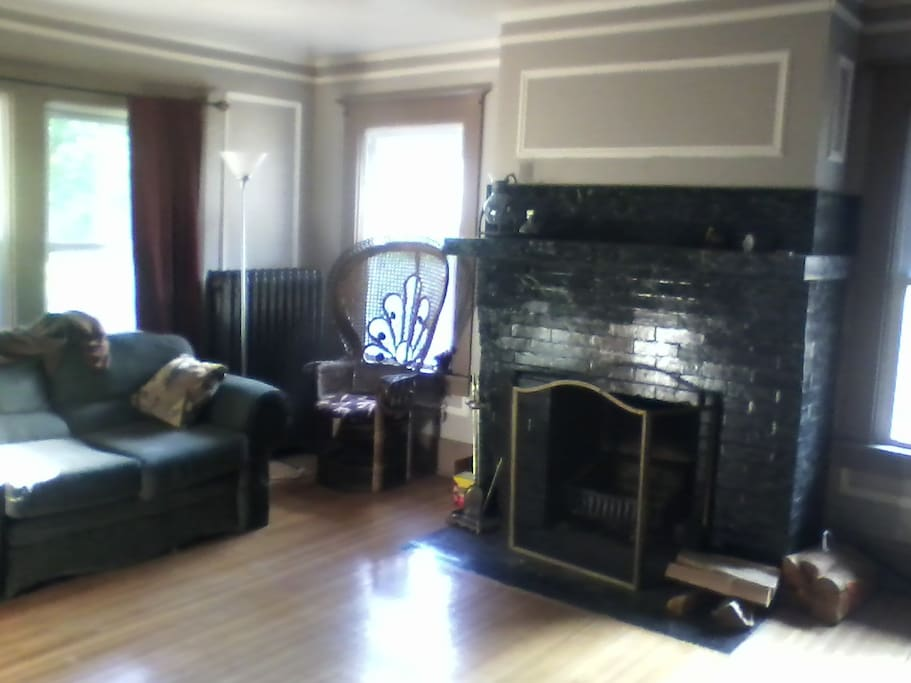 Living Room with working Fireplace. Hardwood floors. Cozy in winter.