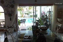 view from the living room to the pool area