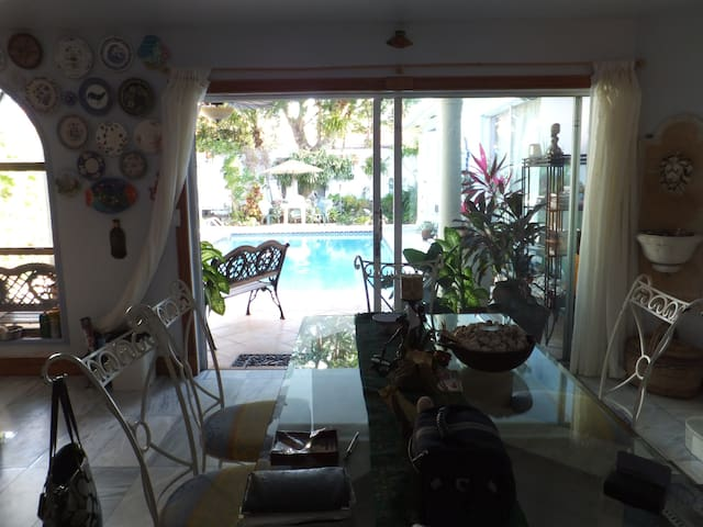 DINING ROOM TABLE AND POOL AREA