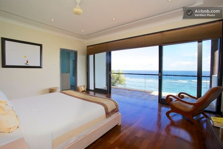 Third bedroom is upstairs on the second story and gets great ocean views from the bed.  Each bedroom has private bathroom.
