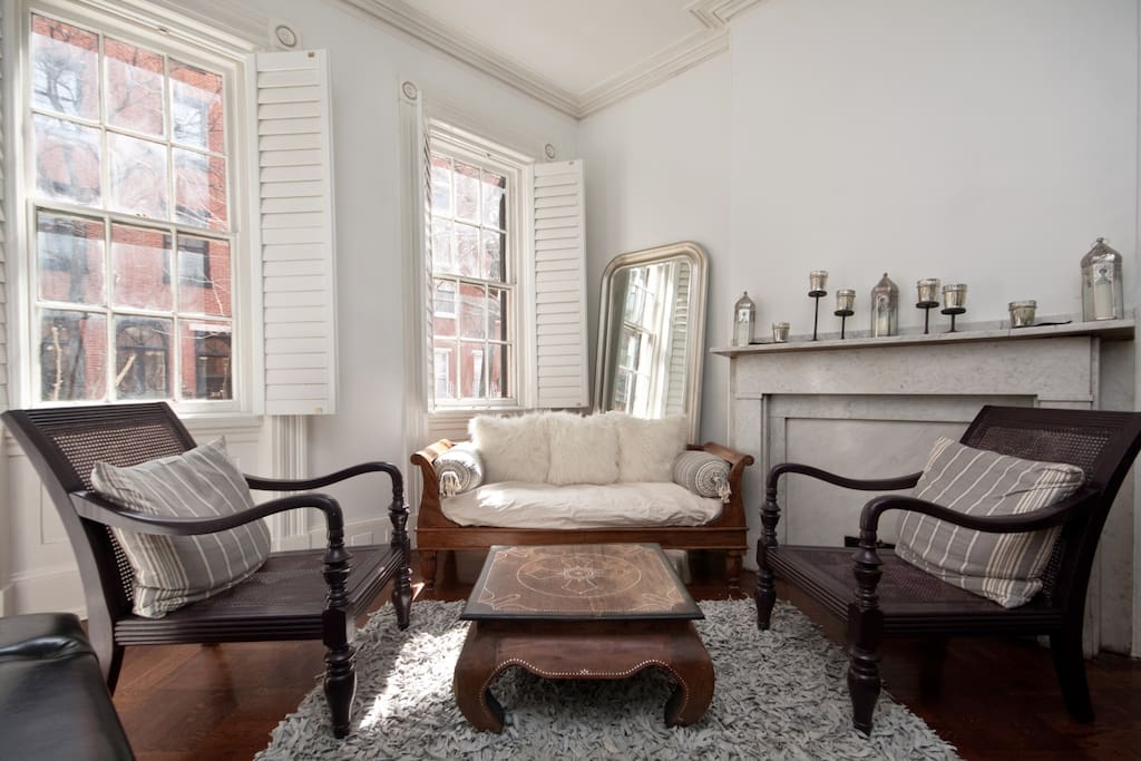...enter the home and on your left is a parlor room with marble mantle, plaster molding...
