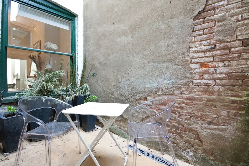 ....before the kitchen is a tranquil patio, perfect for morning coffee...