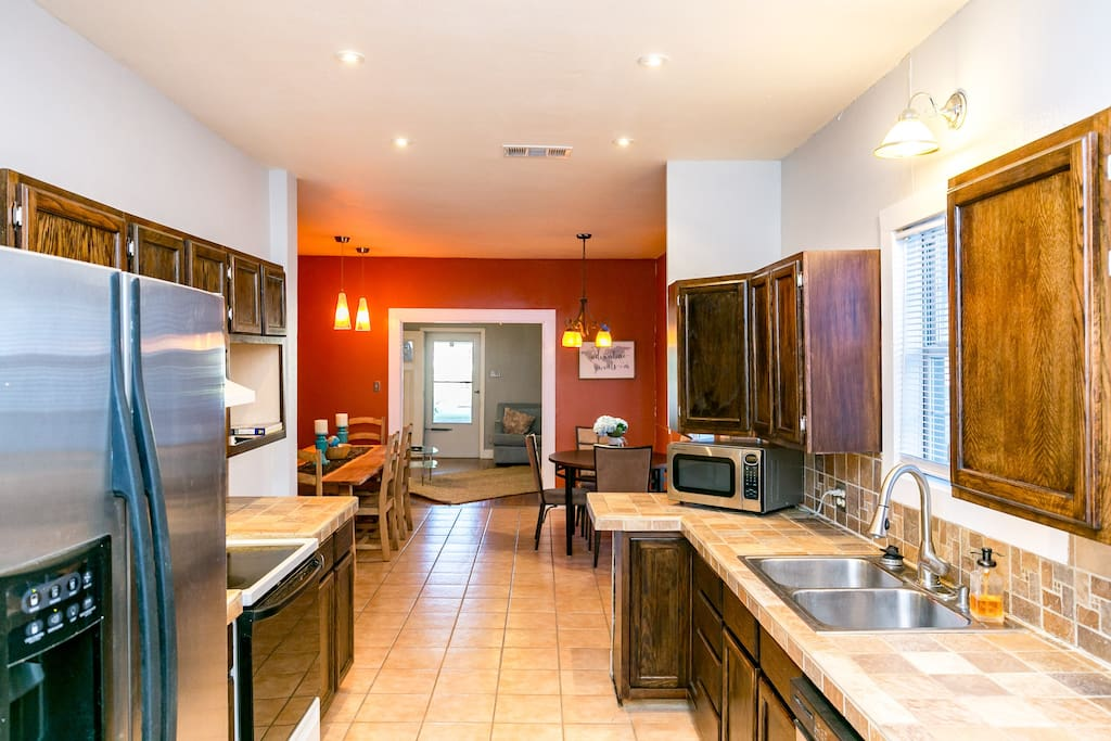 Large galley kitchen and huge dinning area with two dining tables and seating for 12 plus