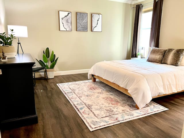 Master bedroom on main floor with new California King bed and Sealy Posturepedic mattress and luxurious linens.