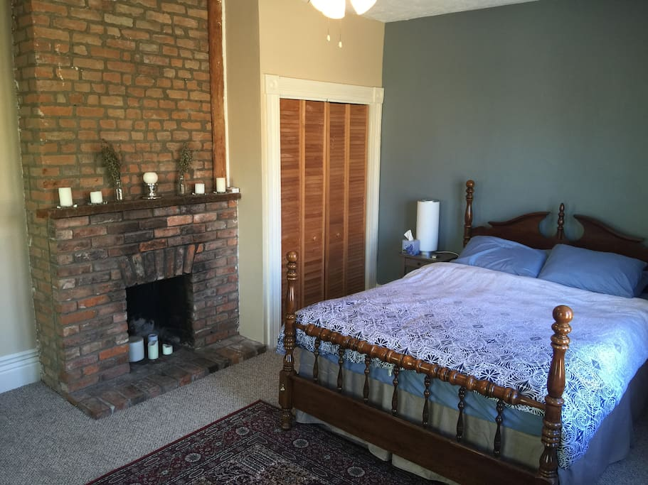 Bedroom 1: Relax and enjoy the sunny, west-facing bedroom with queen bed and fireplace.