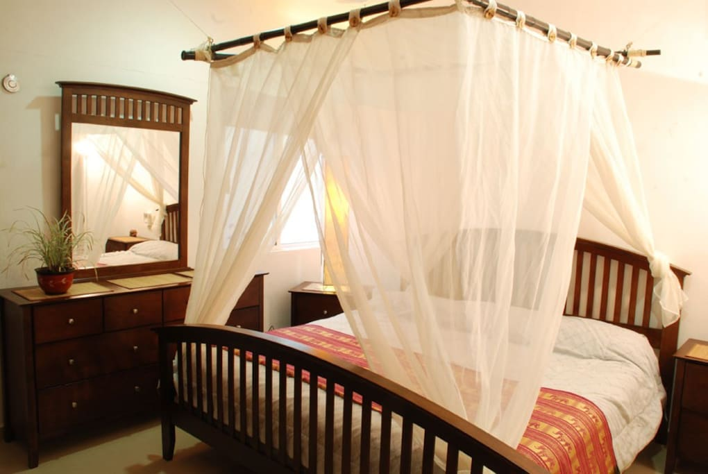 Romantic master bedroom with private en-suite bathroom and king-size bed