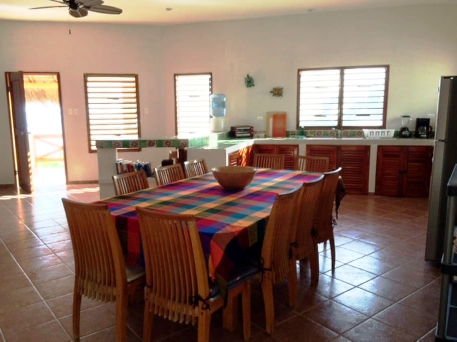 Open great room plan, fully equipped kitchen and dining area