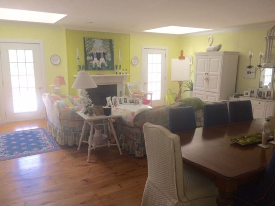 Great room with dining area & doors to deck