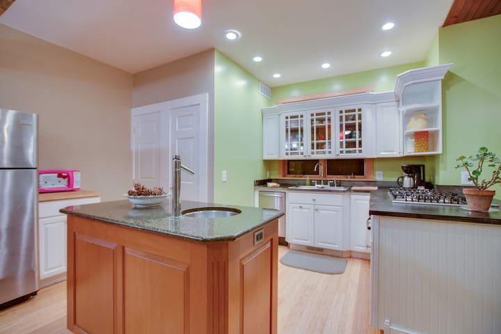 The kitchen has a cherry island with a granite top, and everything you need to cook a nice meal.
