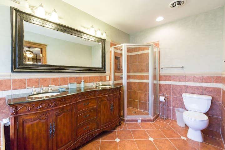 Enjoy this Spacious Bathroom with Granite Coutertops and 2 Sinks to Share. Jucuzzi is here, but not shown in this photo.