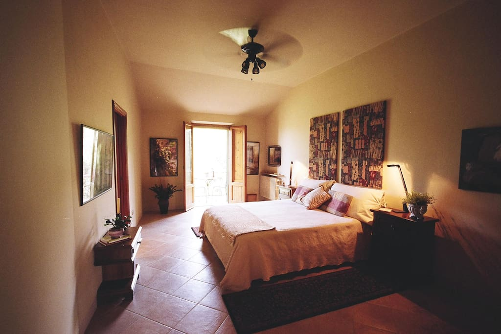 Bedroom with king size bed and french doors opening to balcony