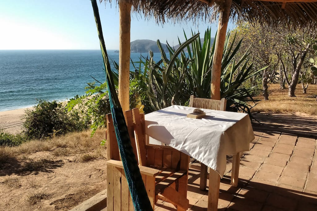 Hammock, breakfast table and ocean... the front porch of Cabaña 1