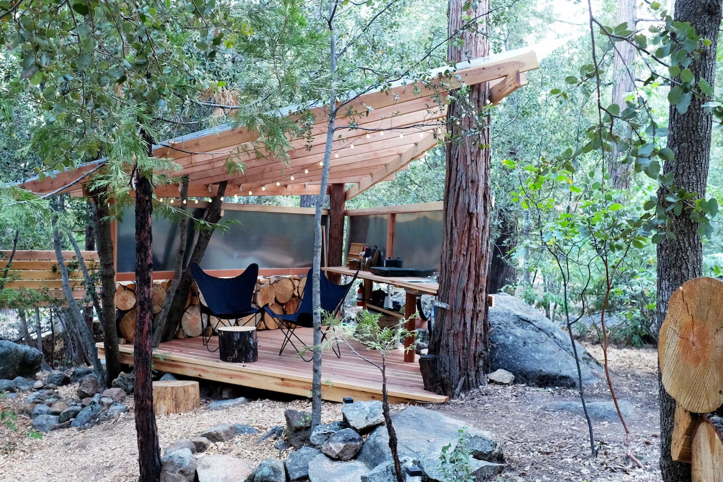 Welcome to Camp Owl Pine - Hang/kitchen deck (vintage butterfly chairs, camp stove, sink, Yeti)