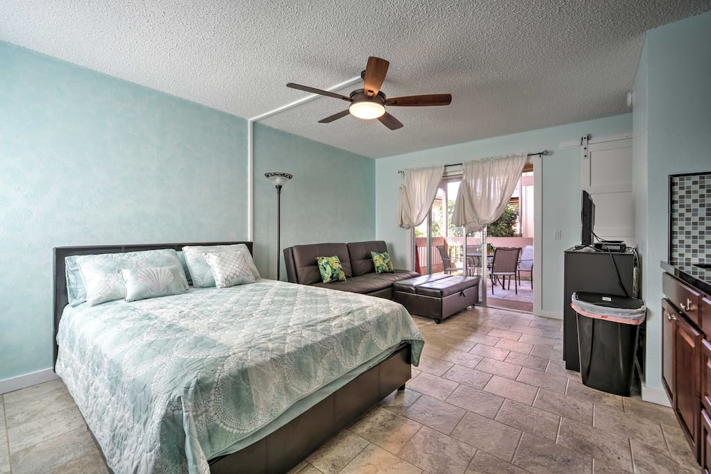 The lovely home is freshly painted in soft hues of light blues and greens.