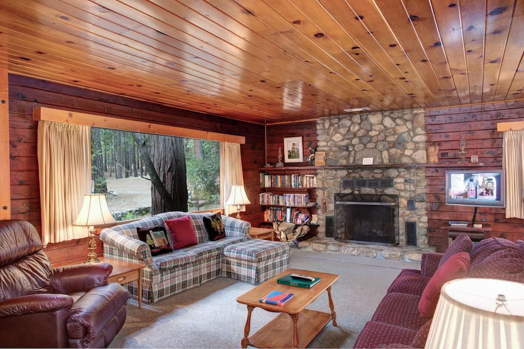 Living Room with Rock Fireplace and large picture window