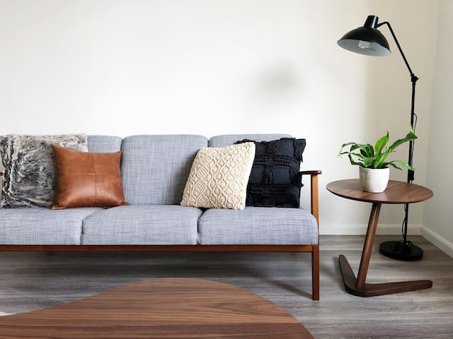 Spacious living room, comfy couch and perfect styling to make you feel at home