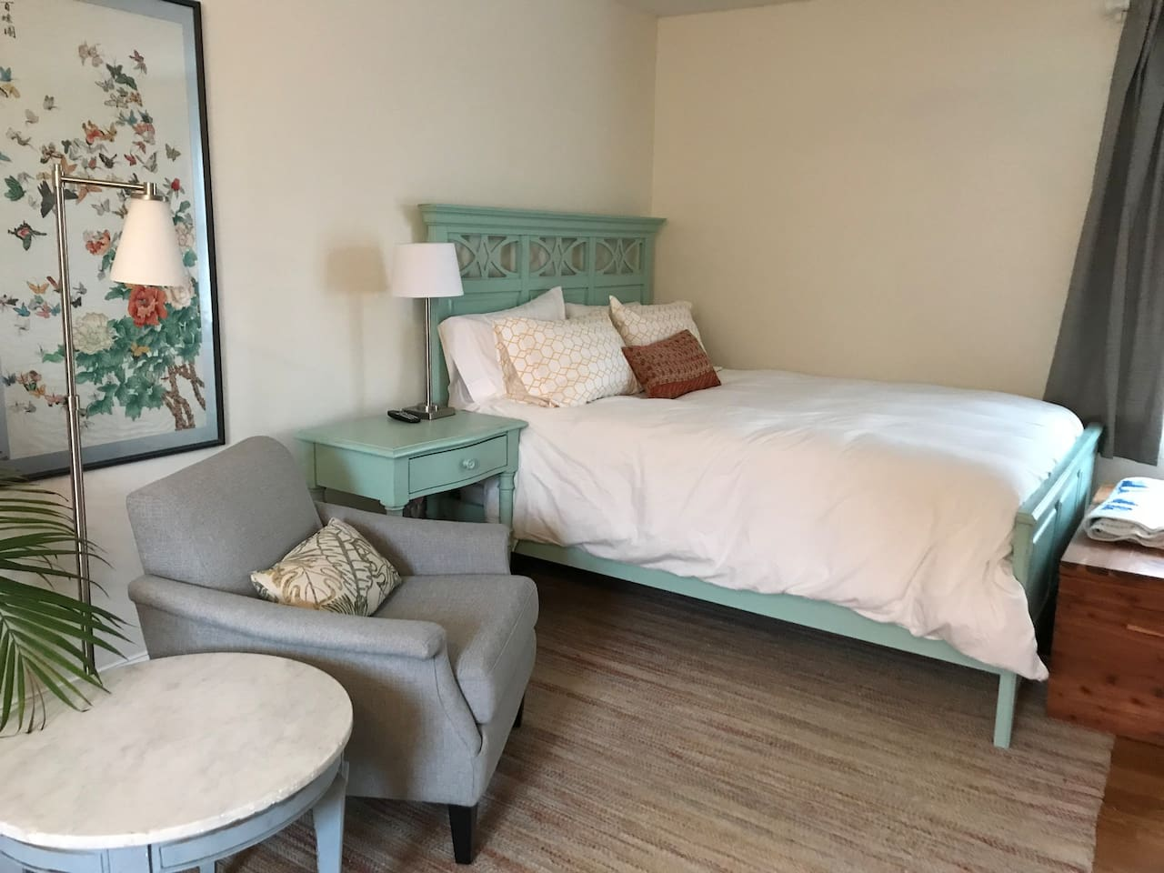 Comfortable Queen size bed and sitting area. Bed has all cotton linens and down comforter with cover.