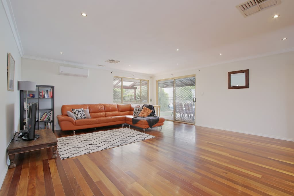 Lounge with tv, book shelf, exit to outdoor alfresco area