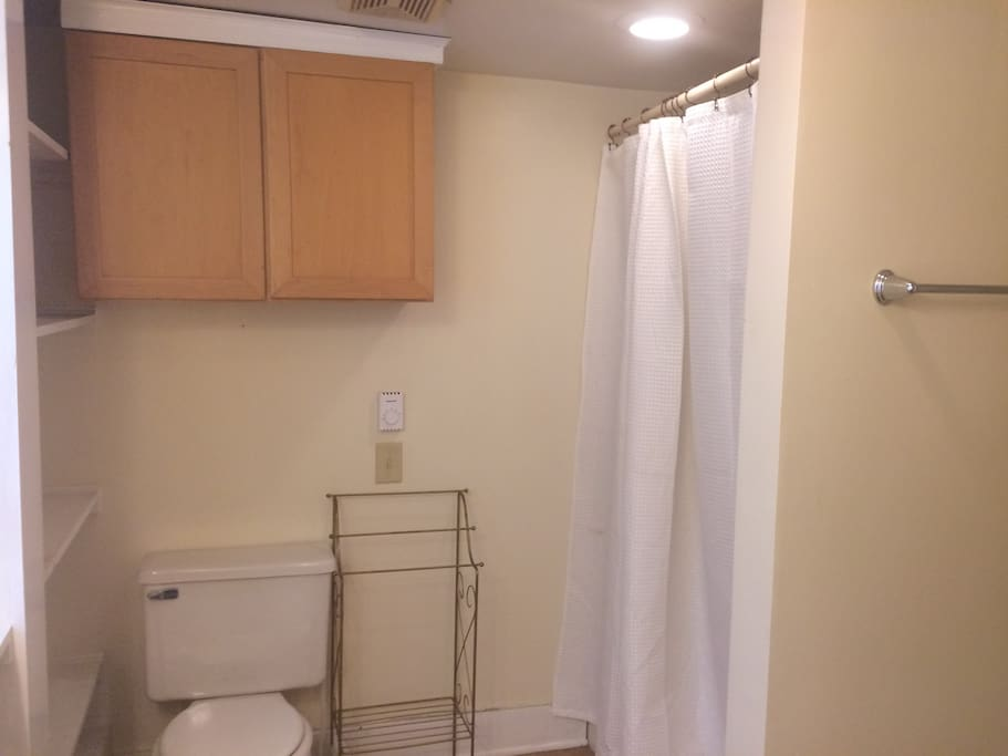 Leslie's Room is steps away fro a shared, full bathroom with a shower stall.