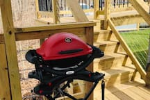 Weber gas grill, and spices are located in the Buffett cabinet.