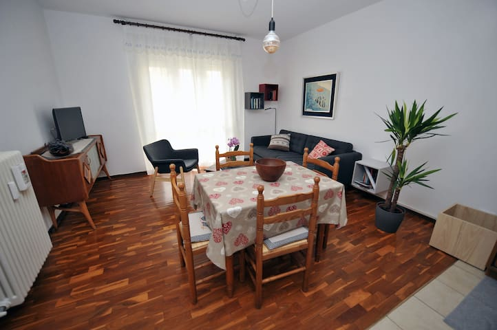 Living room with new 3-seater sofa and armchair, TV, bluetooth JBL speaker and dinner table for 4.