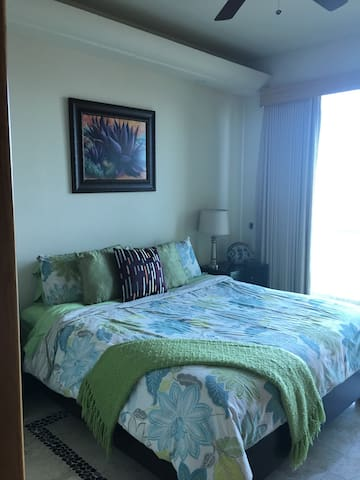 Third bedroom with king size bed and private balcony overlooking the estuary