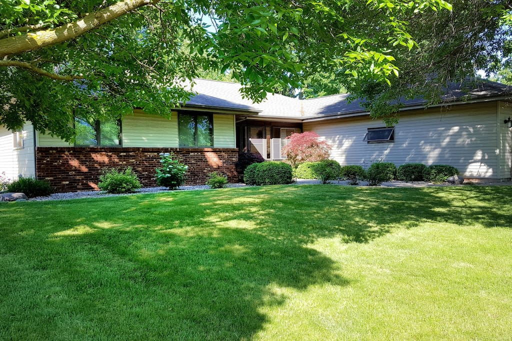 Screened in front porch and rose lined walkway to your front door. 2.5 car garage with plenty of extra parking in the driveway!