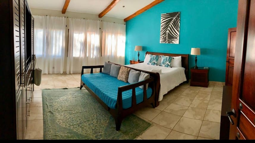 King size bed with luxury imported linens and ensuite bathroom.  Twin daybed to watch TV or read a book on a cozy couch or for extra sleepers.