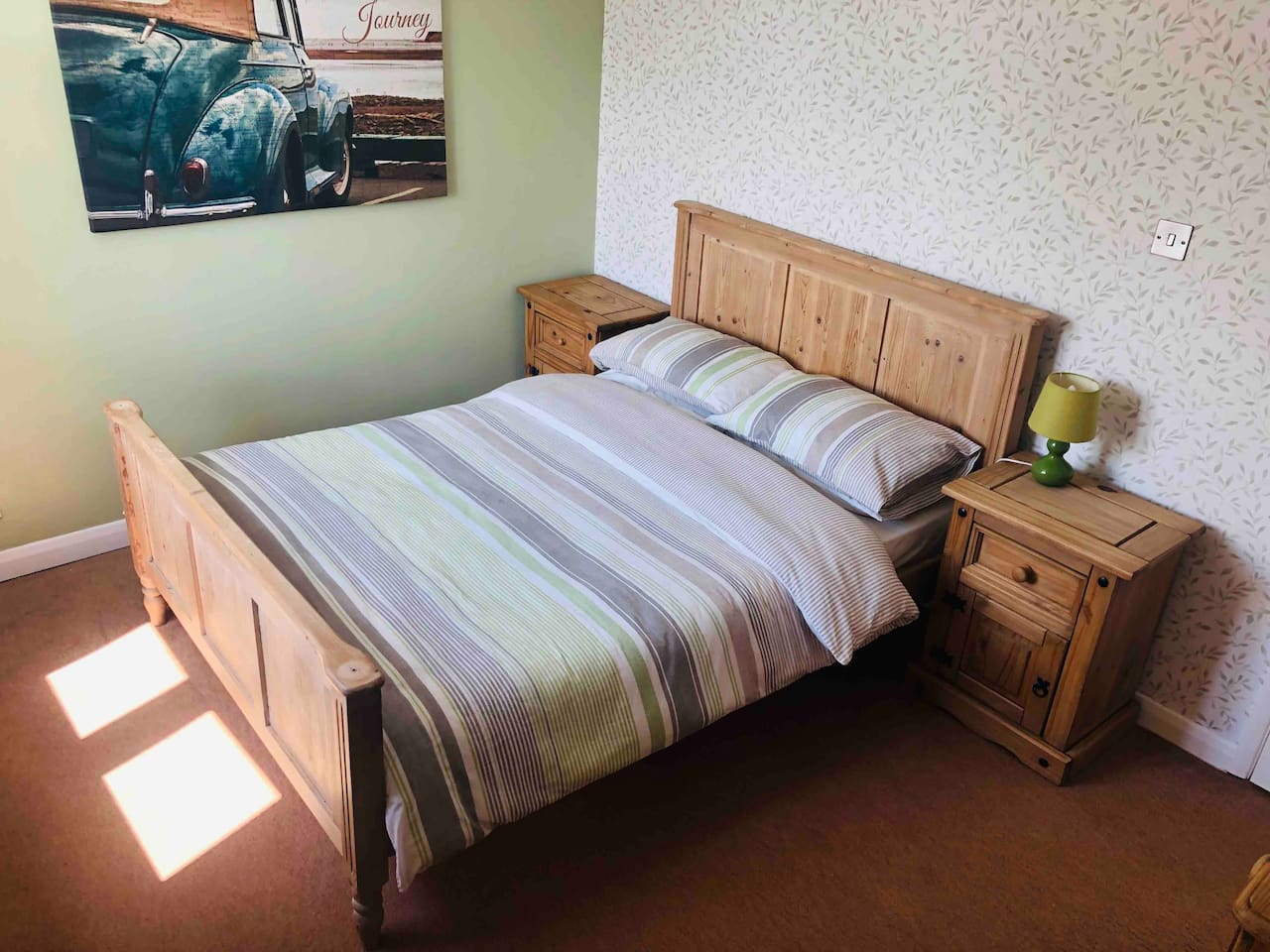 A large double bedroom with built in wardrobe and a TV with free view with a homely feel.
