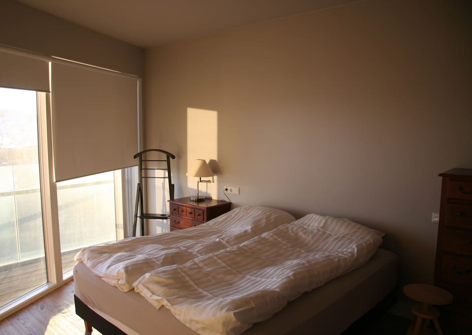 Master bedroom with double bed and bathroom ensuite