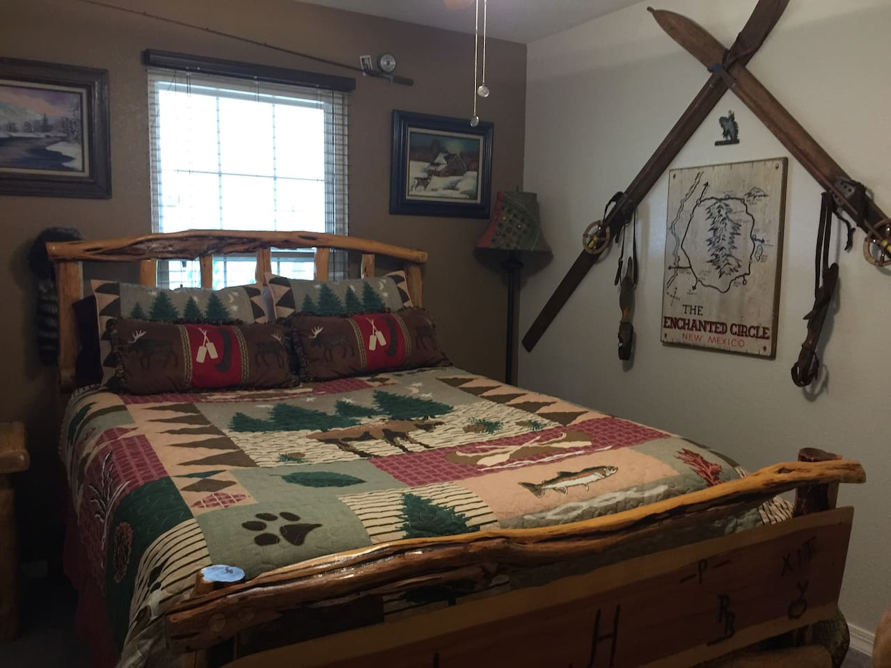 Guest room decorated in mountain motifs and souvenirs from our travels in New Mexico and Colorado.