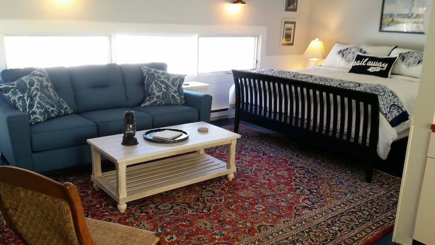 Studio design with king bed and new furniture and updates