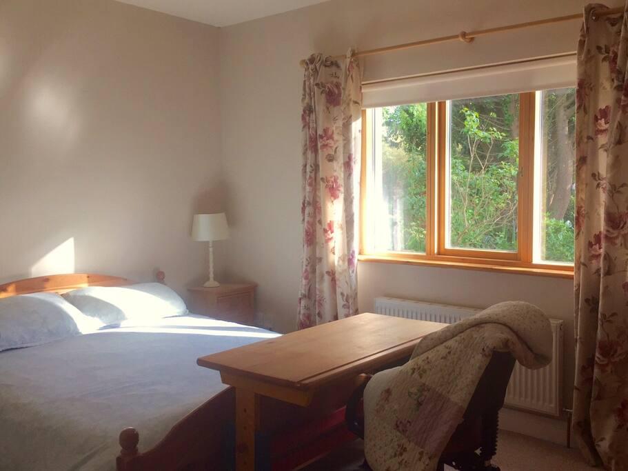 Double bedroom within guest annex overlooking quiet front garden.