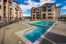 Relax in the heated pool or hot tub situated directly underneath the mountain with spectacular views! Just inside the door is sauna, steam room showers and a full gym.
