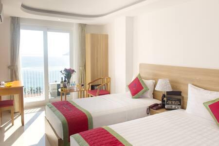 Deluxe Triple Balcony Sea View-Siren Flower Hotel - tp. Nha Trang
