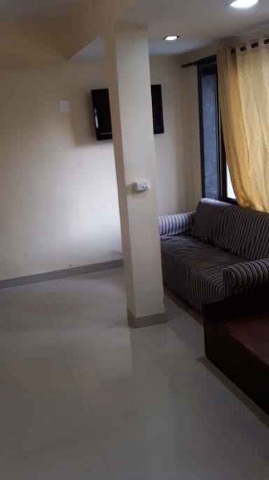 3rd Sofa Bed + Sofa at Living Room with Wall TV