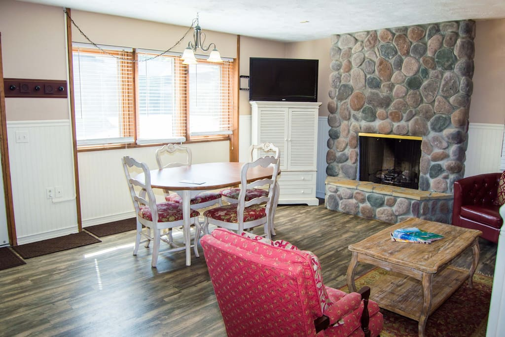 Nice fireplace and much seating in the living/dining area.