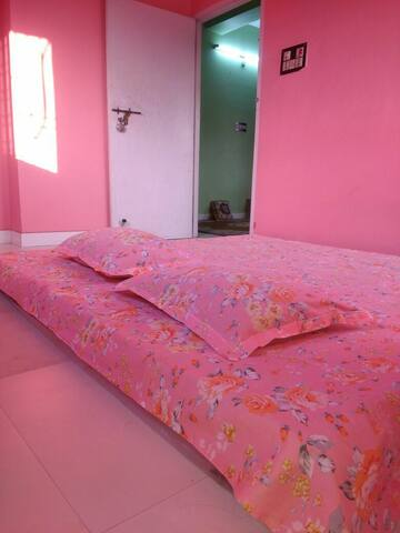 A comfortable private room with AC, WiFi, and hall