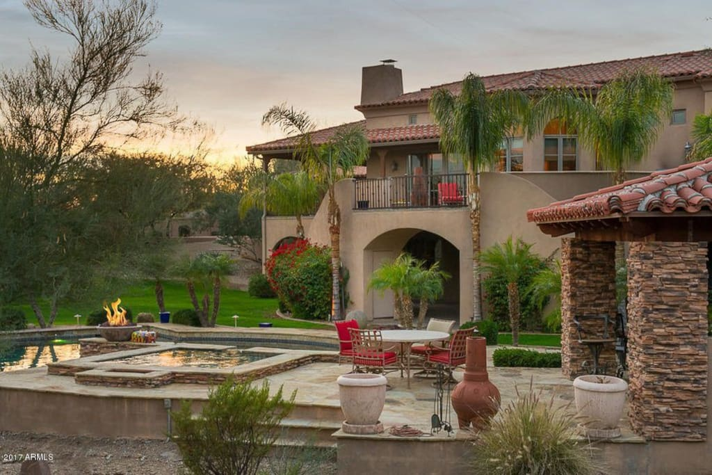 One of the most private homes in the valley sitting on over 2 acres of manicured grounds with large pool, Jacuzzi, barbecue grill, lounge chairs and multiple outdoor sitting & dining areas!