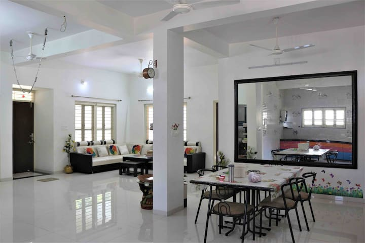 Huge hall with sitting sofas, T V area, dining area attached to kitchen. Nice place for food & family gathering.