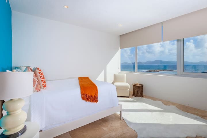 2nd of 2 queen bedrooms with ensuite bath and ocean view.